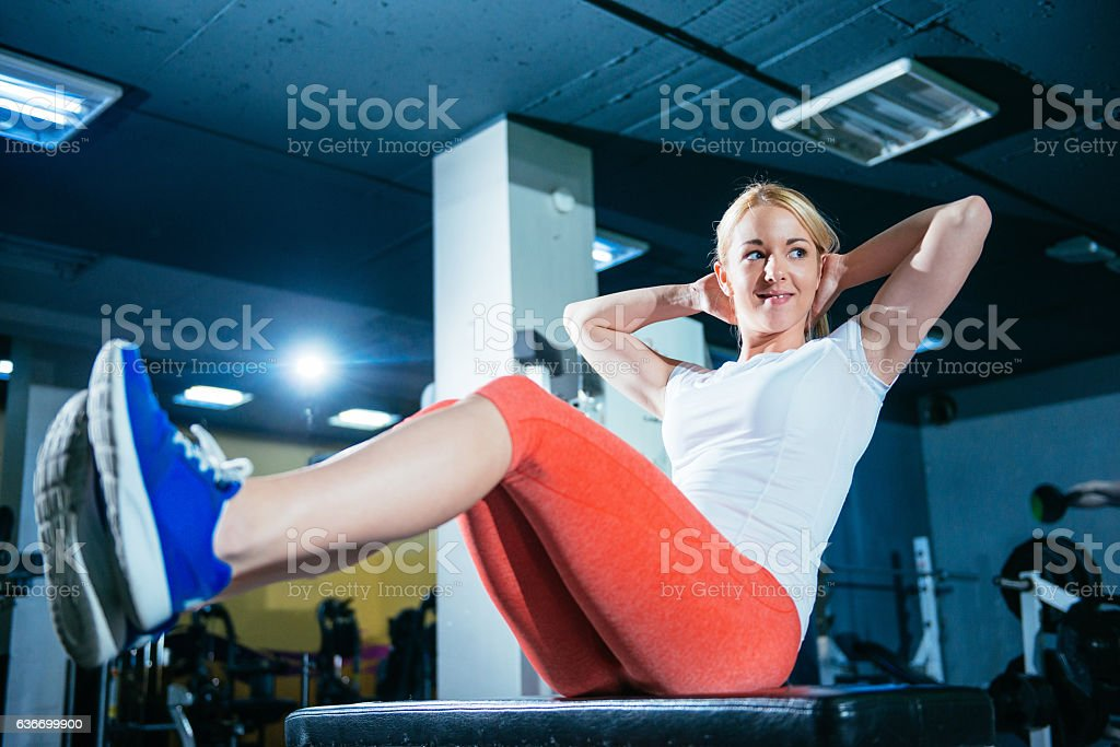 Athlete woman doing sit ups for abdominal muscles in gym stock photo
