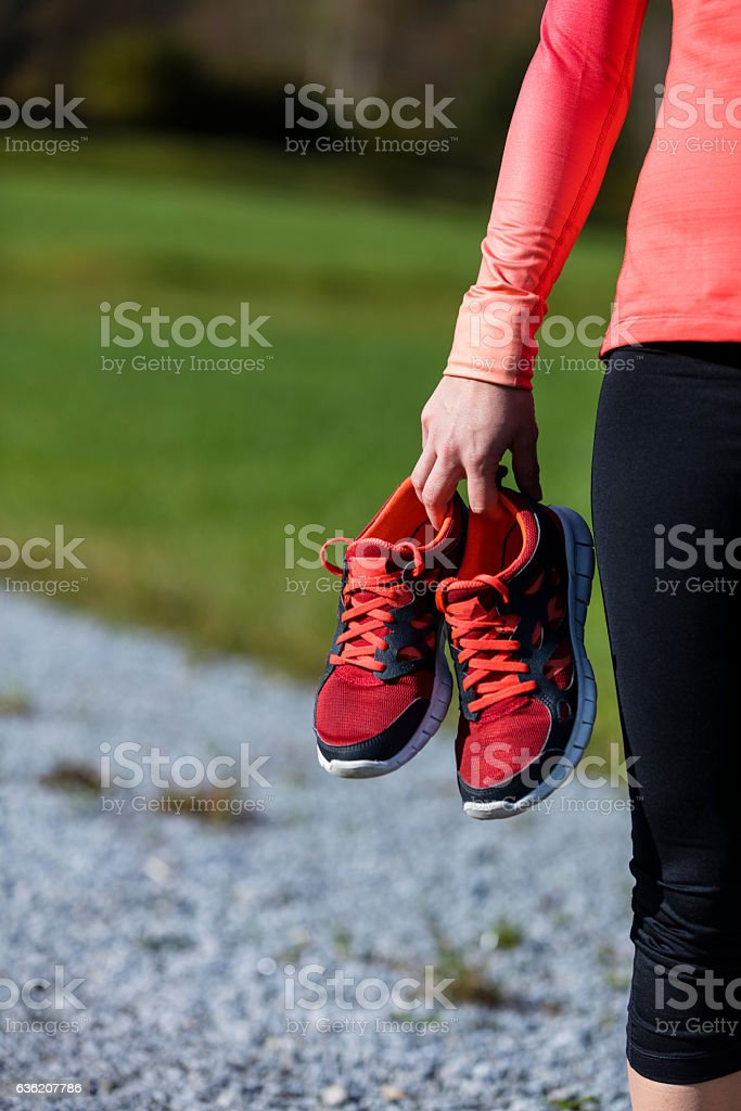 Athlete woman preparing for outdoors training stock photo