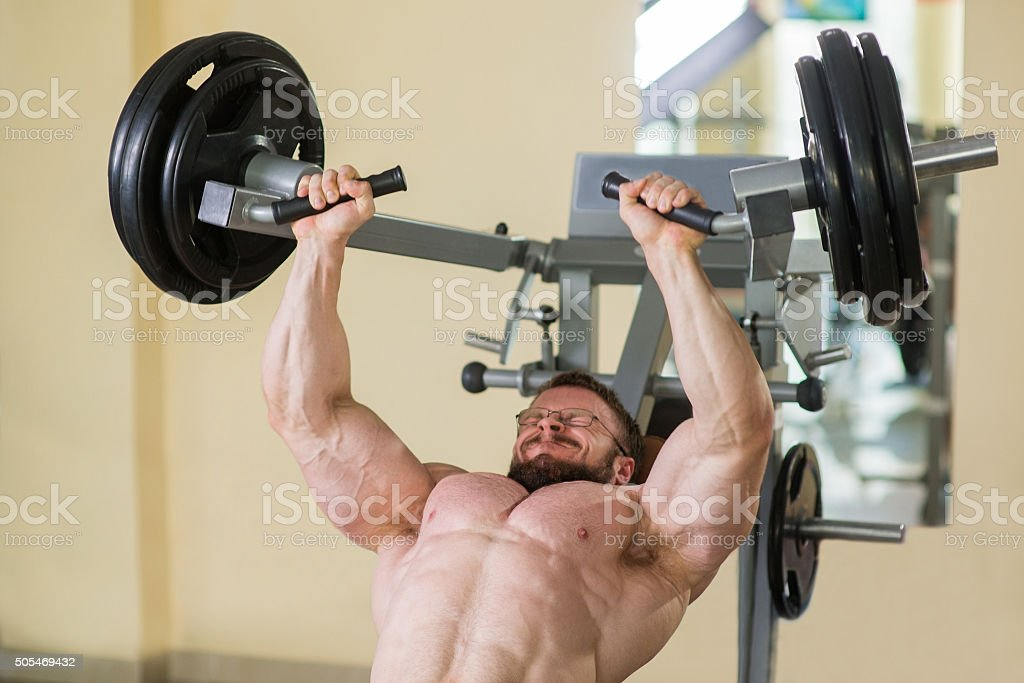 Athlete working out in gym. stock photo