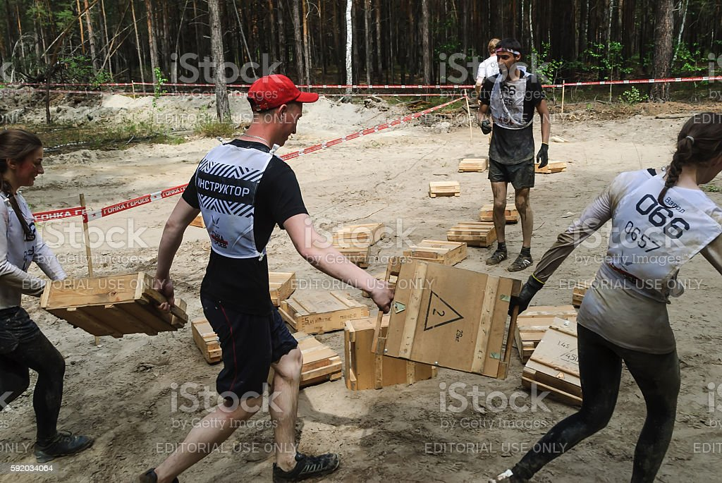 Athletes carry out exercise Transfer of boxes stock photo