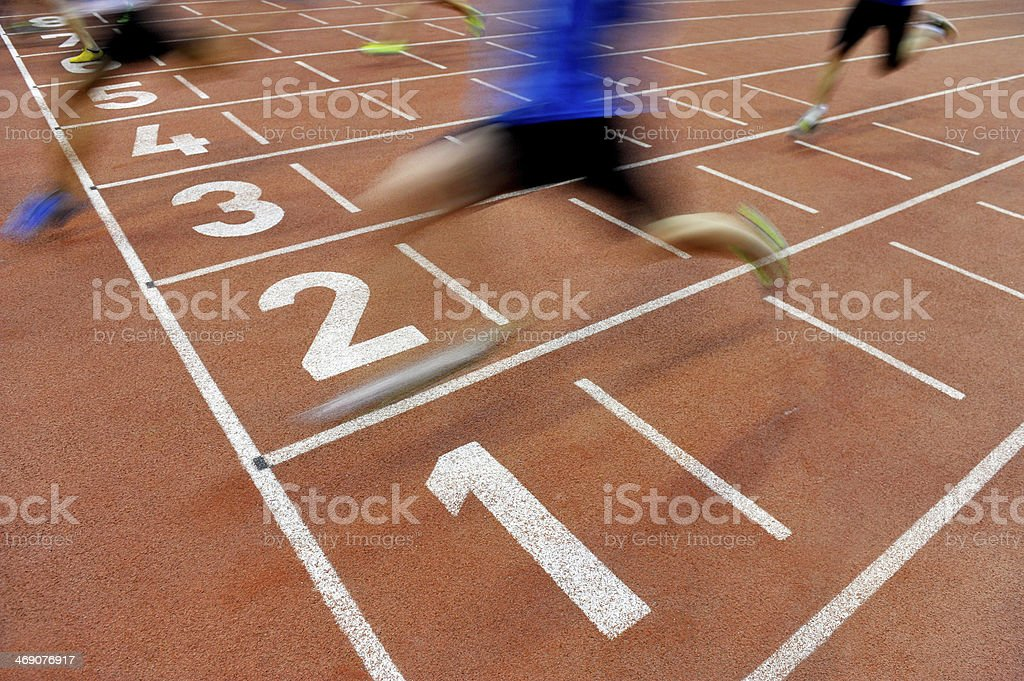 Athletes cross the finish line stock photo