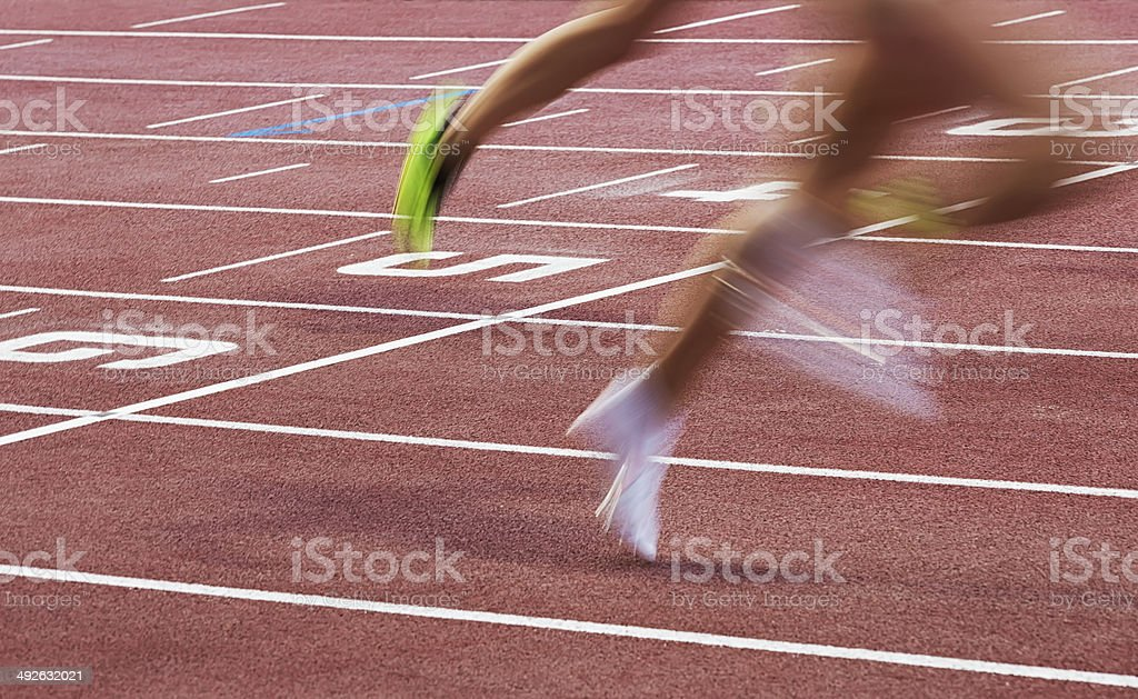 Athletes Crossing the Finish Line stock photo