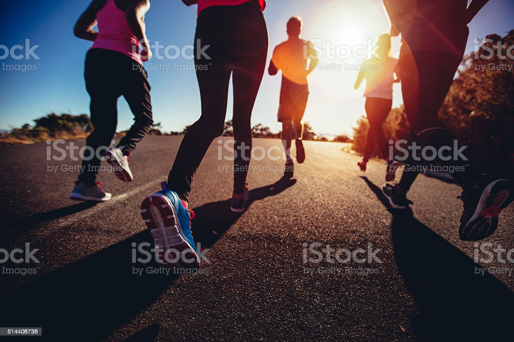 Athletes doing a jogging workout outdoors stock photo