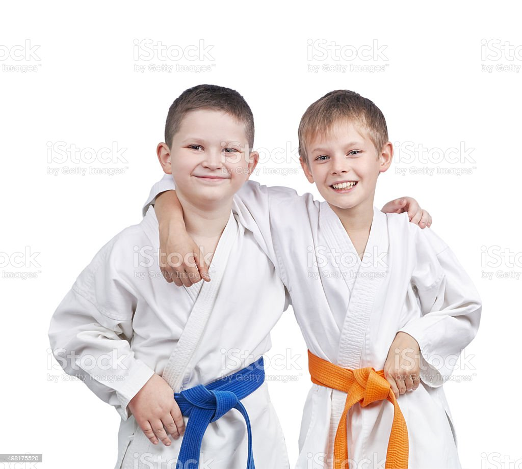 Athletes in a kimono and with different belts stock photo