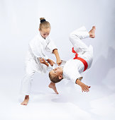 Athletes in judogi are training throws