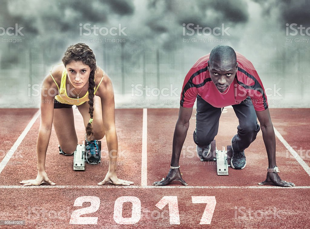Athletes in the starting blocks stock photo