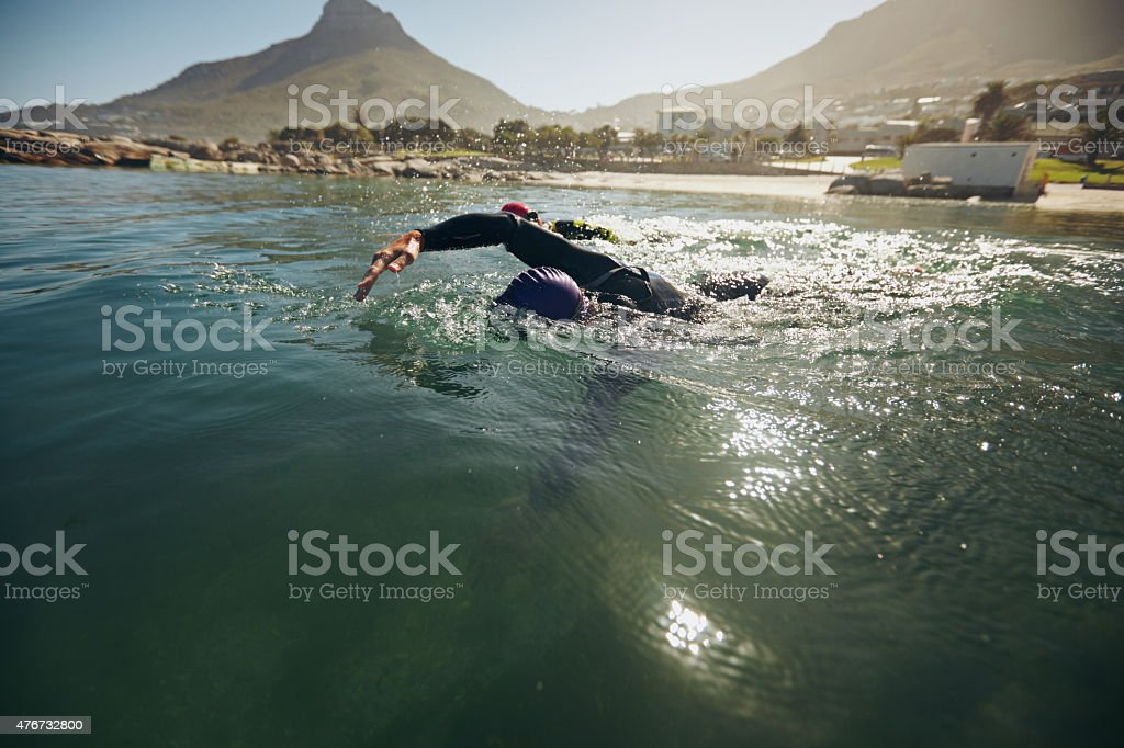 Athletes in the swim event of a triathlon competition stock photo