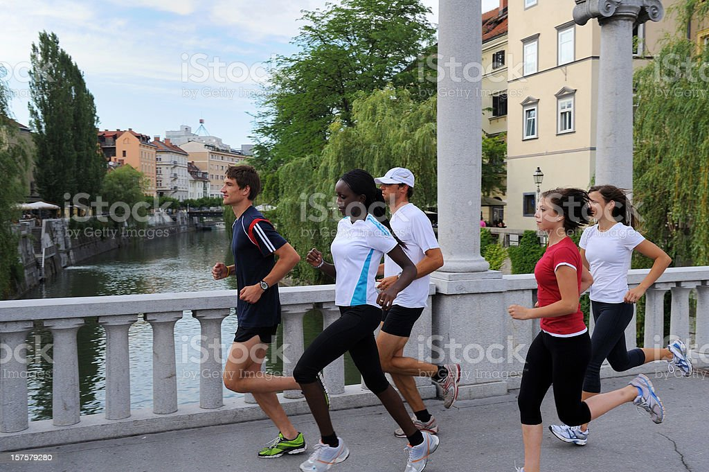 Athletes jogging in the downtown royalty-free stock photo
