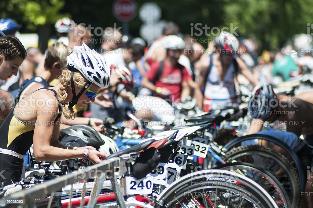 Athletes preparing equipment for a triathlon competition royalty-free stock photo