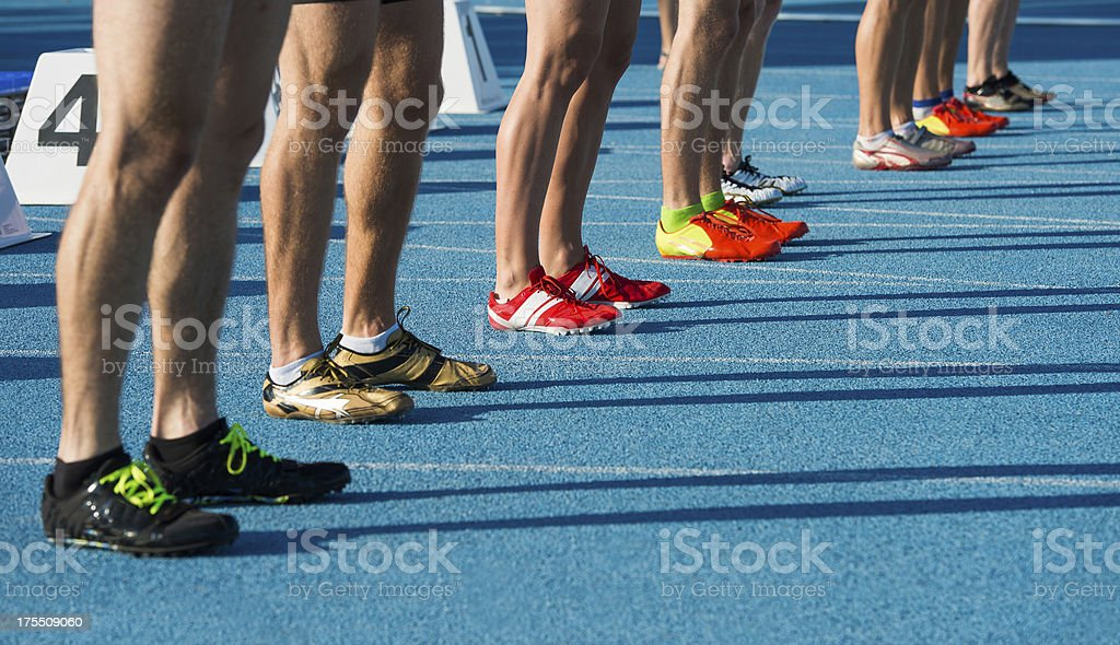 Athletes ready for start at 100m sprint royalty-free stock photo