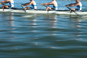 Athletes rowing a crew row boat