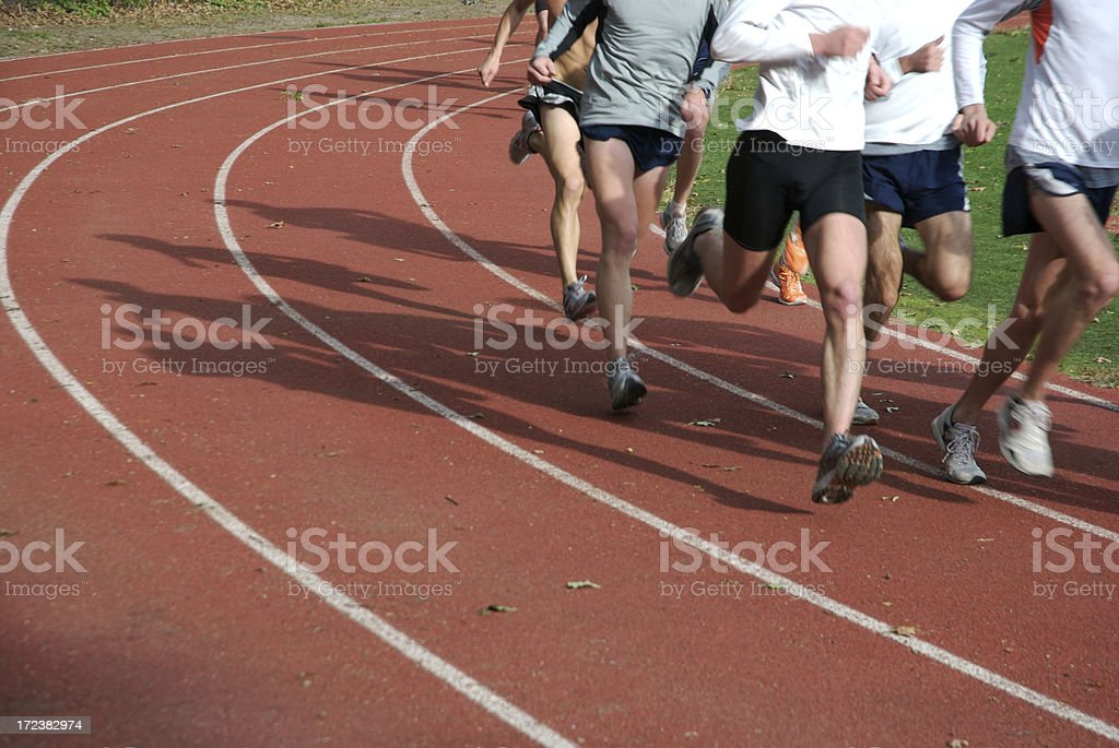 Athletes Running on Red Running Track royalty-free stock photo