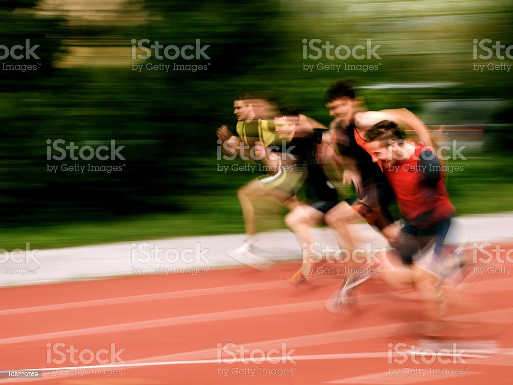 Athletes sprinting stock photo