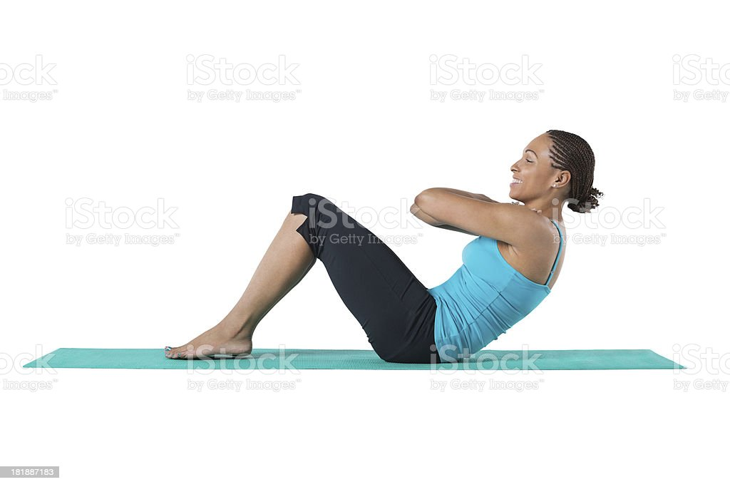 Athletic African American woman doing sit ups; studio shot royalty-free stock photo