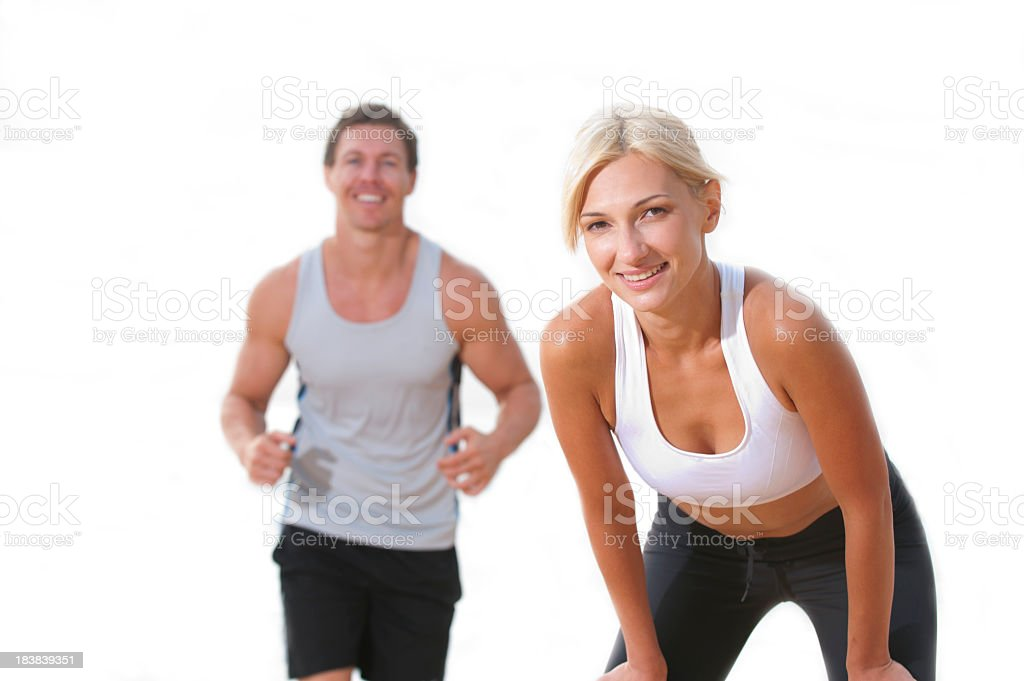 Athletic couple in sportswear posing on a white background royalty-free stock photo