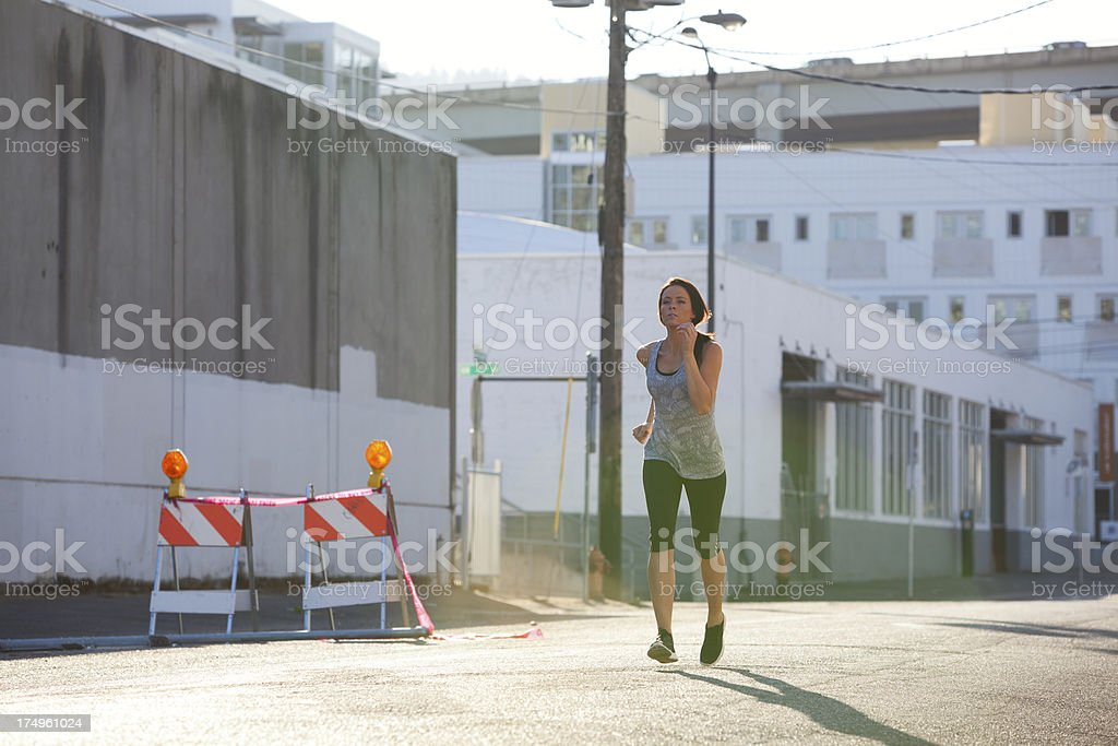 Athletic female running in urban area royalty-free stock photo