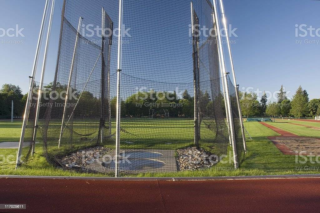 athletic field with a hammer throw cage stock photo