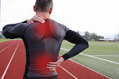 Athletic fitness man with neck and back pain.
