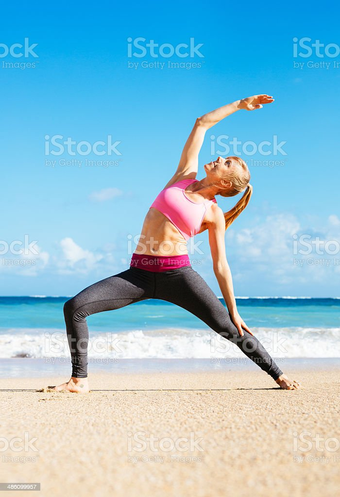 Athletic Fitness Woman Stretching At the Beach, stock photo