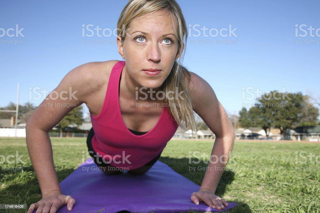Athletic girl doing pushups royalty-free stock photo