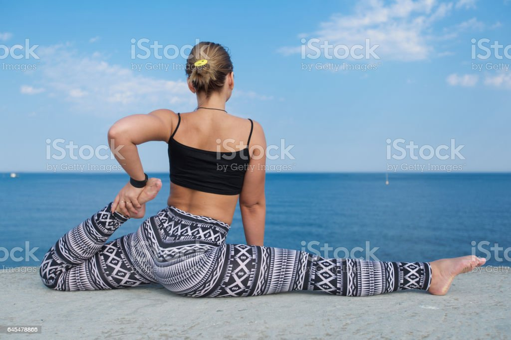 Athletic girl on seafront stock photo