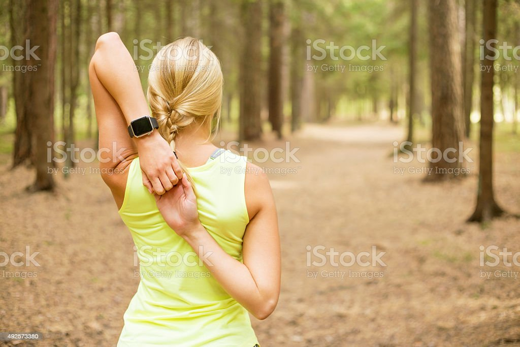 Athletic girl stretching her arms stock photo