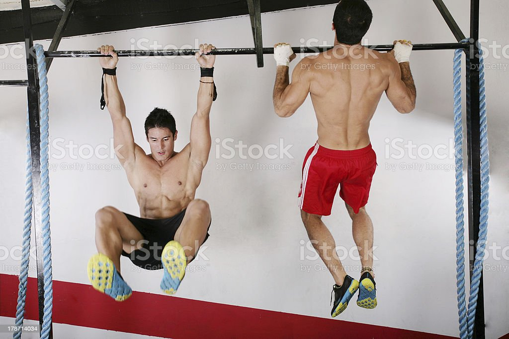 athletic group executing exercise stock photo