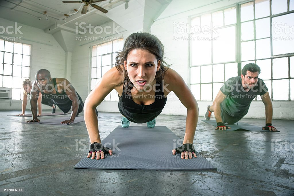 Athletic group fit multi ethnic people exercising vigor vitality passion stock photo
