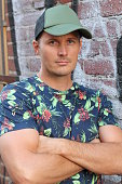 Athletic guy in floral tee shirt