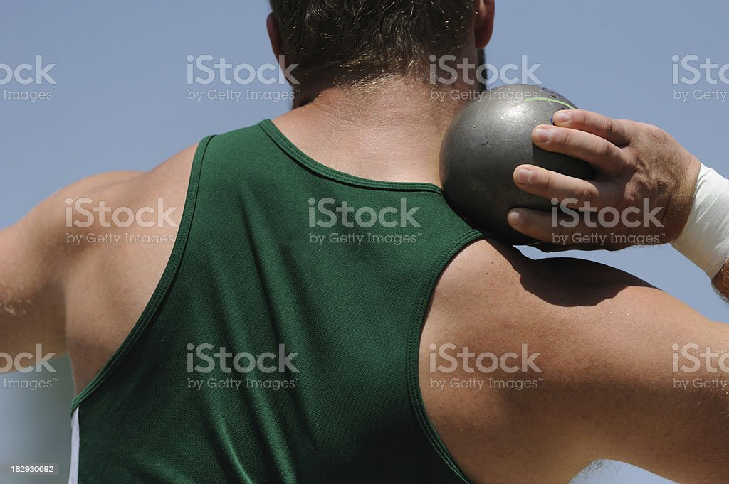 Athletic male at shot put stock photo