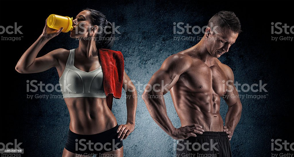 Athletic man and woman after fitness exercise stock photo