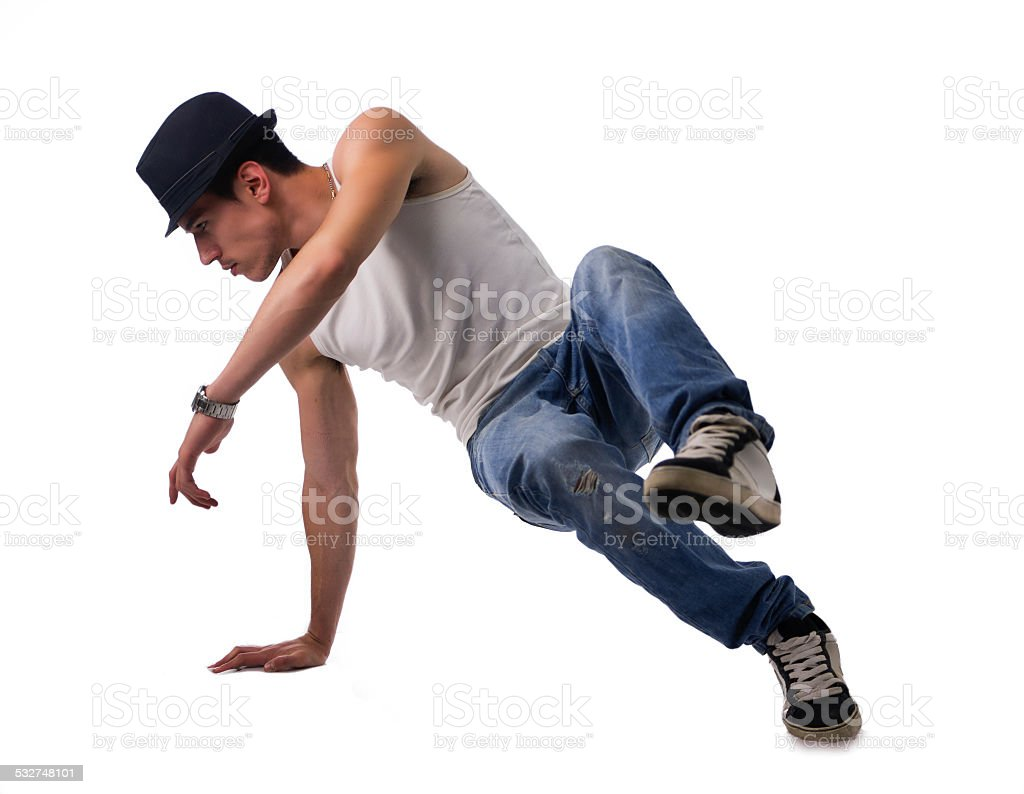 Athletic man doing a break dance routine stock photo