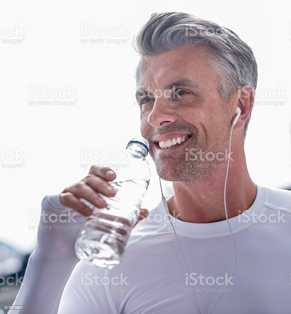Athletic man drinking water stock photo
