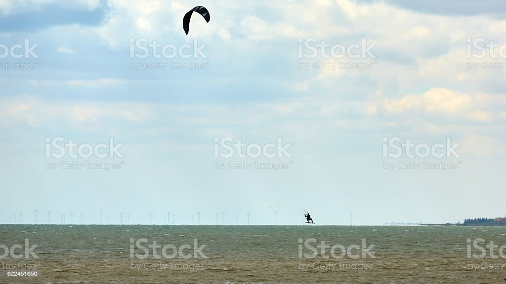 Athletic man jump on kite surf board stock photo