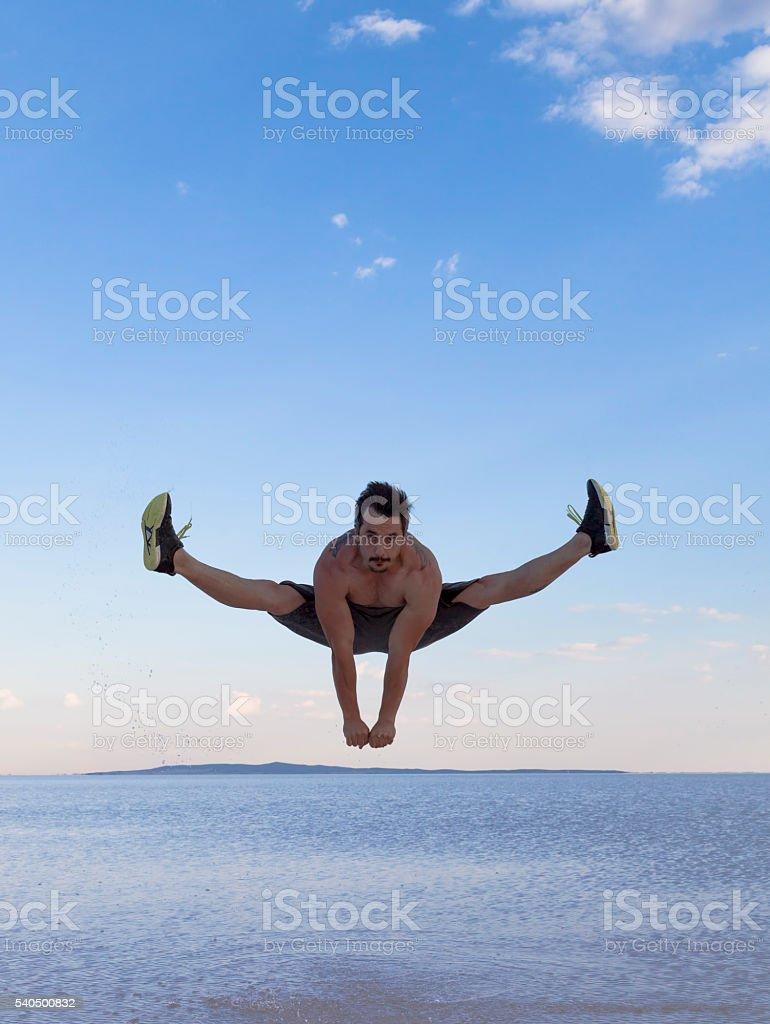 Athletic man jumping stock photo