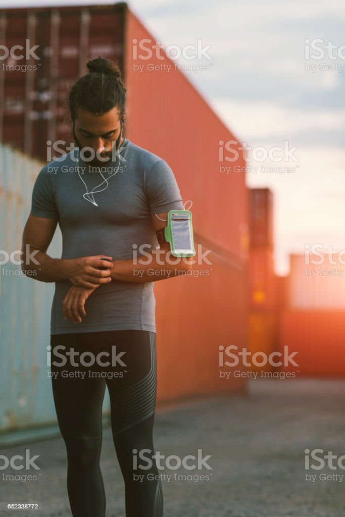 Athletic Man looking in stopwatch stock photo