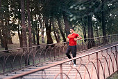 Athletic Man Running On Stairs