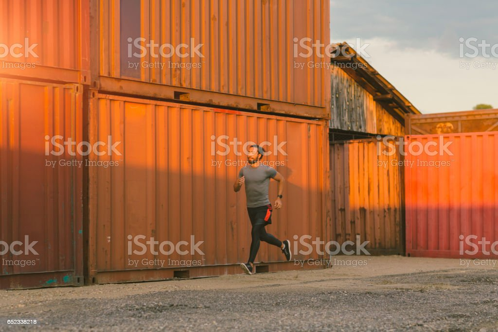 Athletic Man Running Outdoors stock photo
