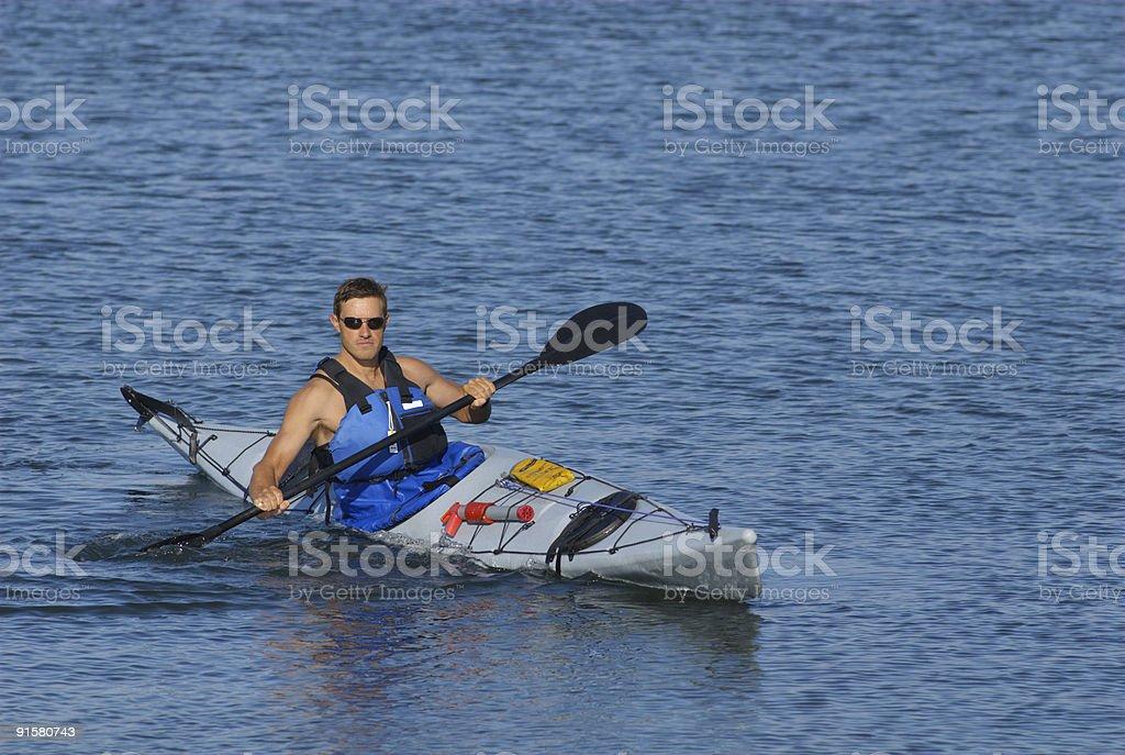 Athletic man showing off his kayaking skills royalty-free stock photo