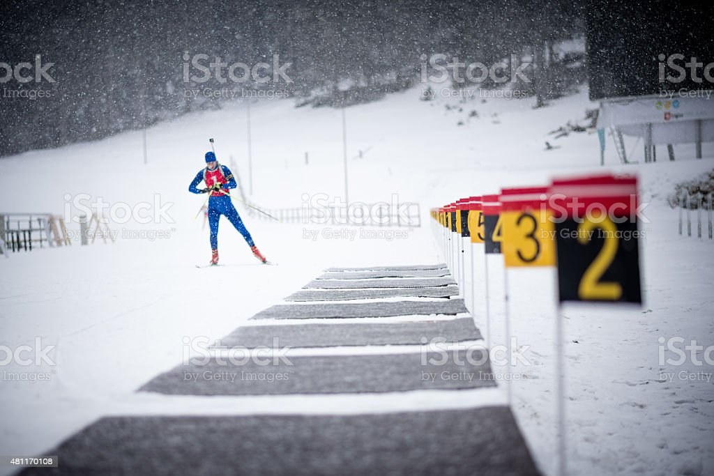 Athletic man standing on snow stock photo