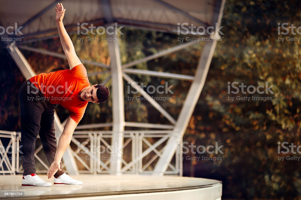 Athletic Man Stretching Before Workout stock photo