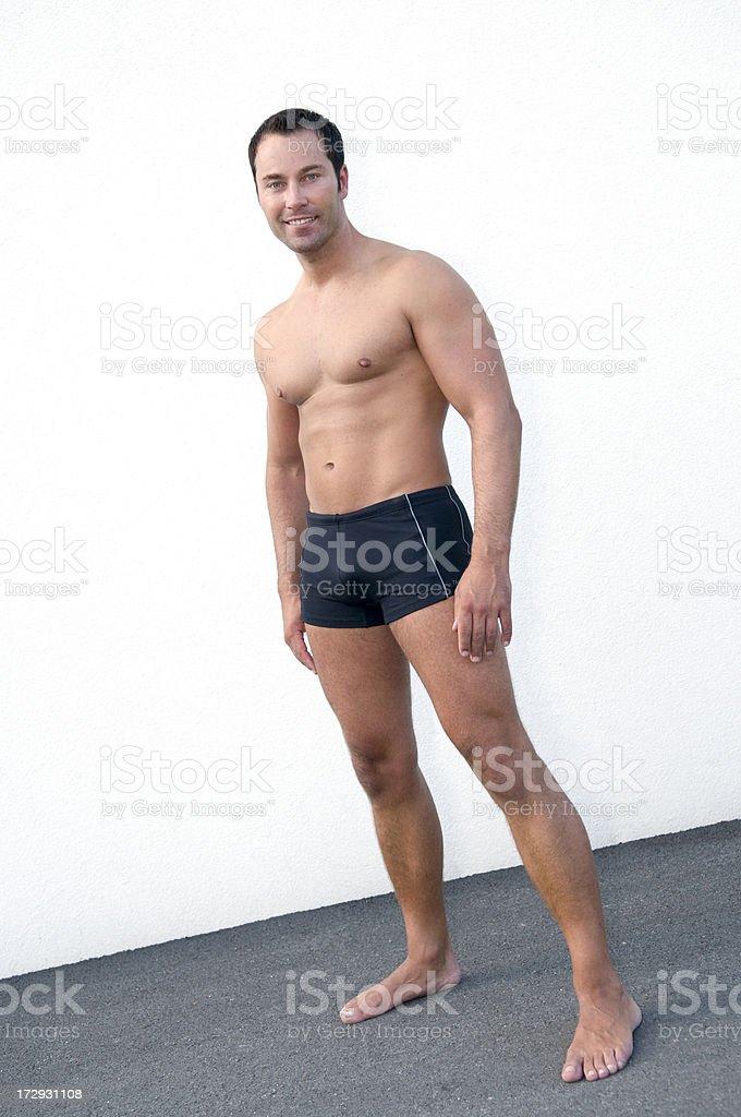 athletic man wearing swimming shorts royalty-free stock photo