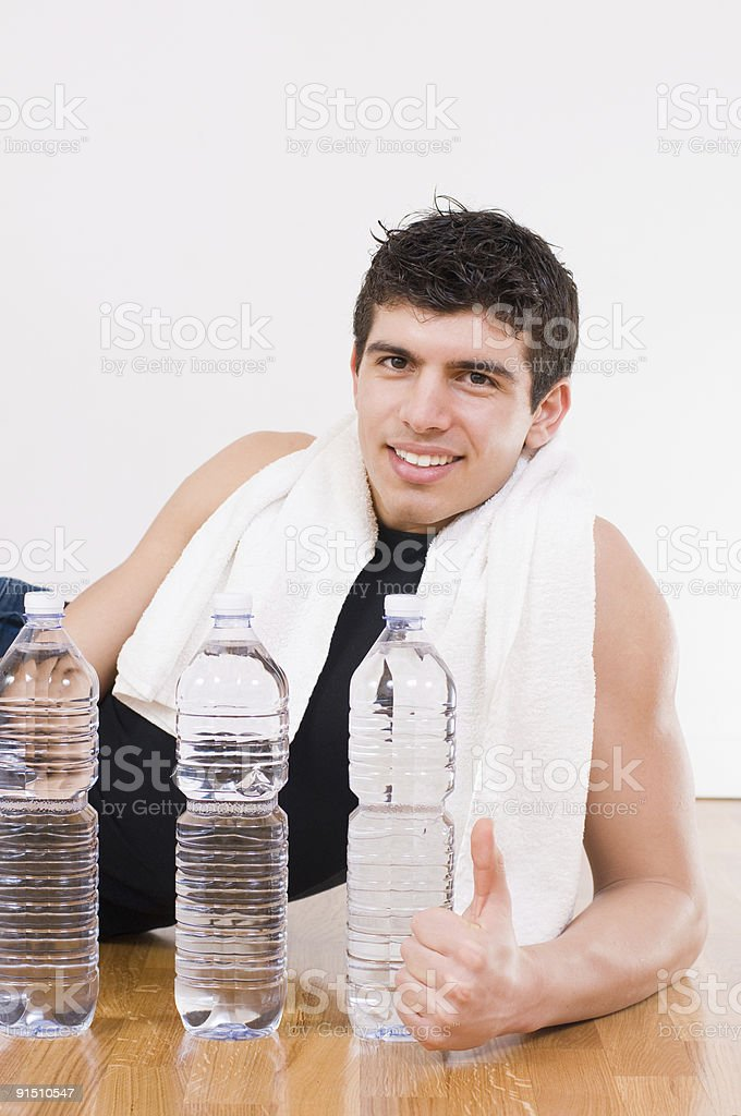 Athletic man with water bottles royalty-free stock photo