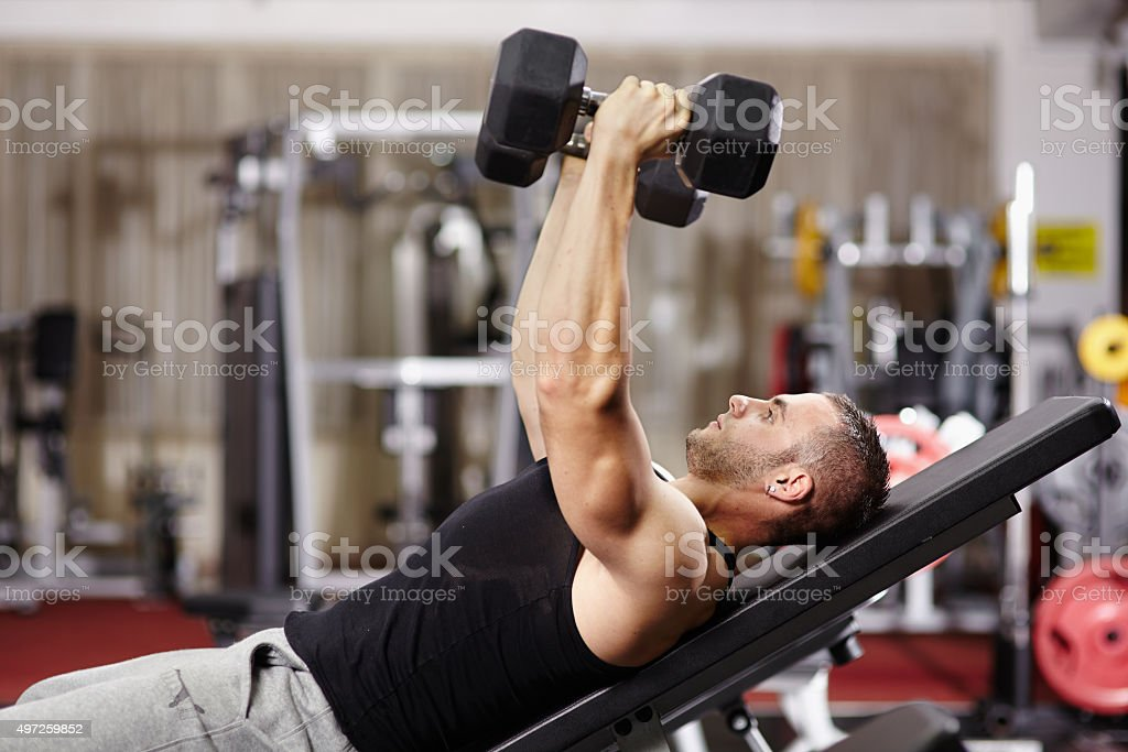 Athletic man working his chest stock photo