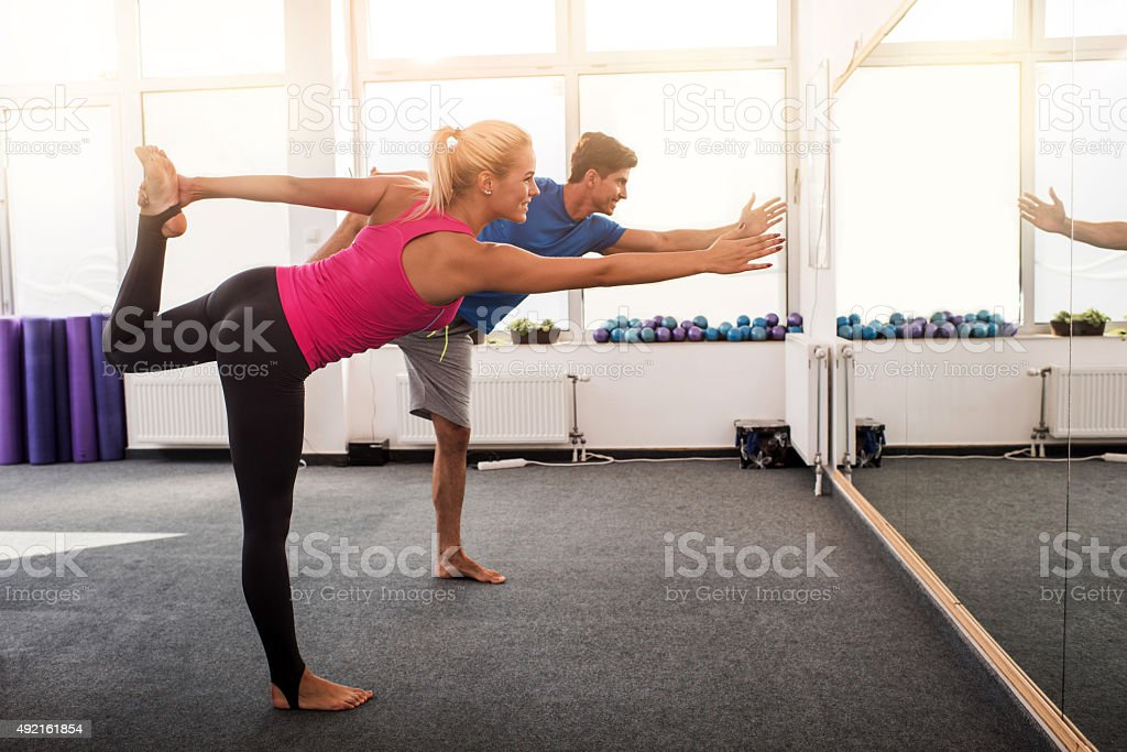 Athletic people doing balance exercises in good posture. stock photo