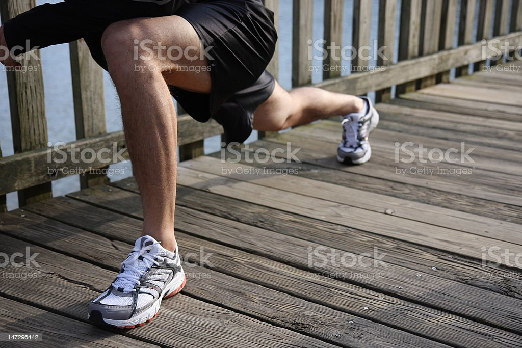 Athletic Runner in a Lunge Stretch royalty-free stock photo