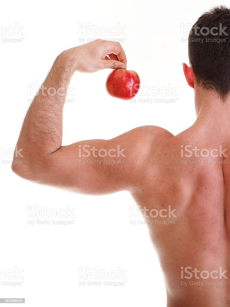 Athletic sexy male body builder holding red apple royalty-free stock photo