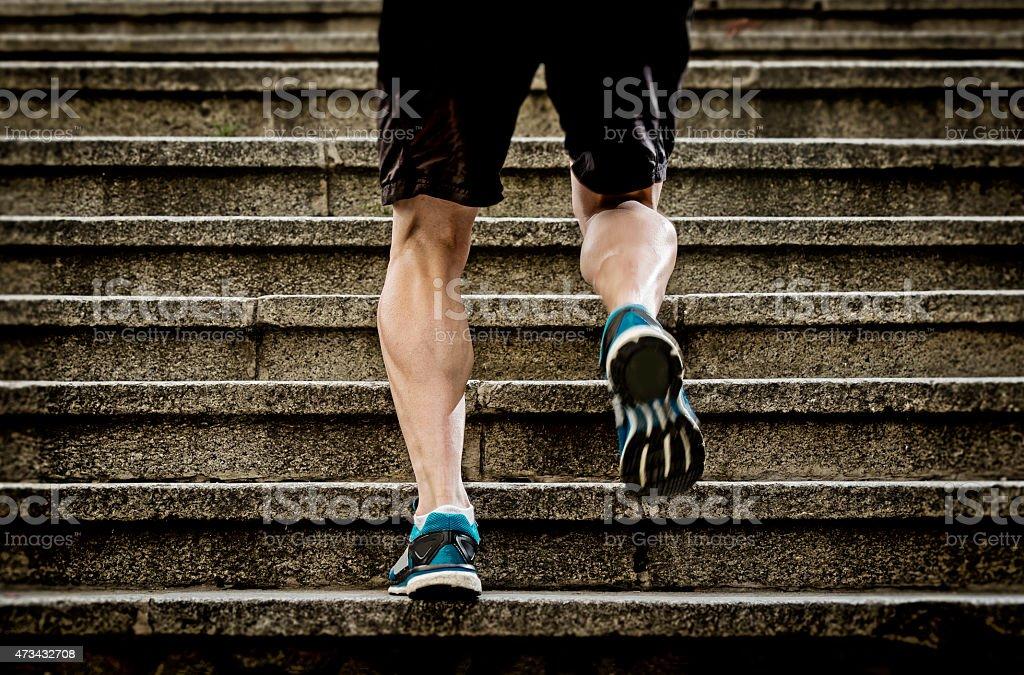 athletic sport runner man running up stairs in urban training stock photo