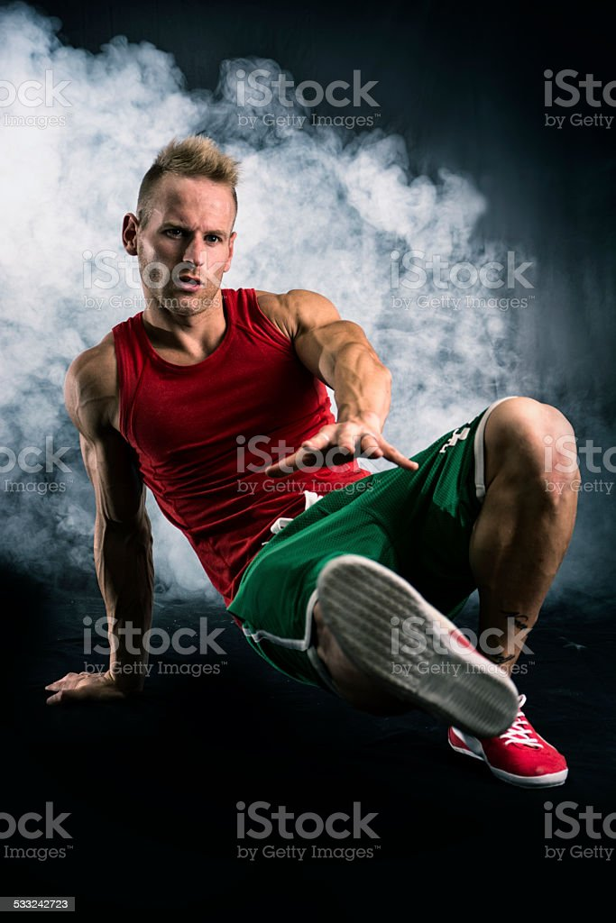 Athletic trendy handsome fit young man in a hat doing stock photo