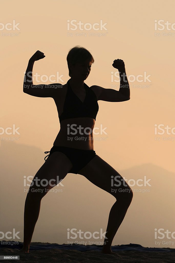 Athletic woman  at sunset stock photo